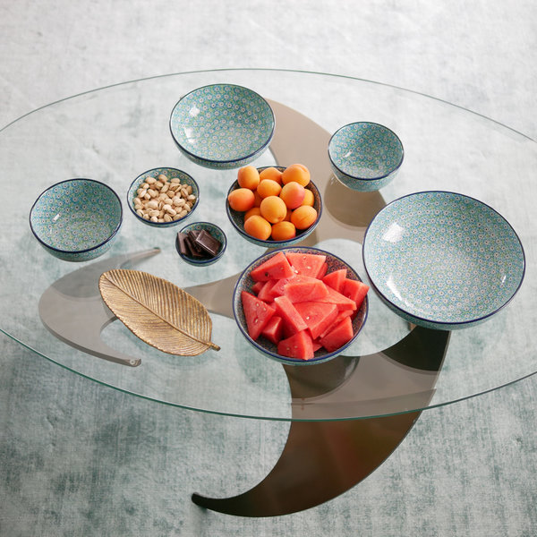 Assorted plates on glass table